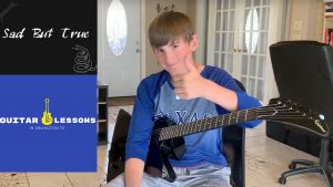 Brendan gives a thumbs up after his guitar lesson in Arlington tx